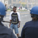 Baltimore youths confront police on April 27. (Samuel Corum/Getty)
